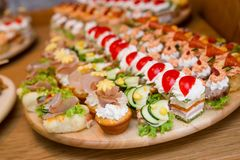 Free Delicious Snacks Of Food Arranged On A Plate Stock Photos - 137362203