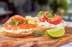 Delicious snacks with shrimp, fish and avocado stock photo