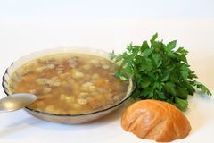 Delicious soap with meat, potato, carrot, parsley for your dinner Stock Image
