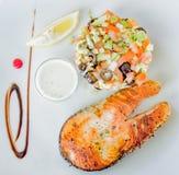Delicious somon and healthy salad royalty free stock photos
