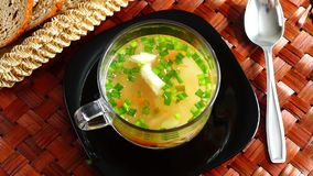 Delicious soup with green onion stock video footage