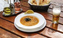 Delicious soup with shrimps, mussels, fish fillet and lemon Royalty Free Stock Photos