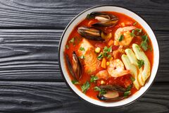 Free Delicious Soup With Seafood, Corn, Celery, Tomatoes, Carrots And Avocado Close-up In A Bowl. Horizontal Top View Stock Photos - 215734813