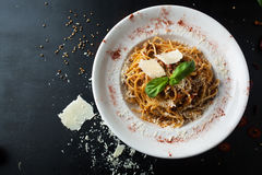 Delicious spaghetti bolognese with cheese and spices and meat Royalty Free Stock Images
