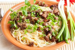 Delicious spaghetti with fried meat Royalty Free Stock Images
