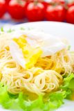 Delicious spaghetti with tomato and poached egg Stock Photography