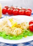 Delicious spaghetti with tomato and poached egg Royalty Free Stock Images