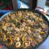 Delicious Spanish Paella, homemade, old recipe learned in Spain. Deliciosa Paella española. Delicious Spanish Paella, homemade, old recipe learned in Spain Royalty Free Stock Photos