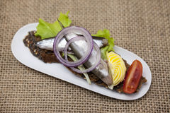 Delicious Spanish tapas with butter and onion salad sprat, Atlantic on slice baguette. An excellent background for the menus, cafe Stock Photo