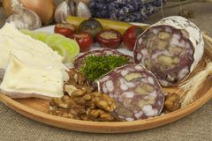 Delicious specialty food, salami with walnuts. Refreshments for important guests. Traditional specialty food. Royalty Free Stock Photos