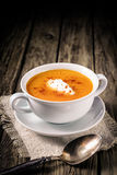 Delicious spicy carrot soup with cream Stock Images