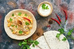 Delicious spicy chicken biryani on a rustic background with spices. Indian or Pakistani food. Top view,flat lay