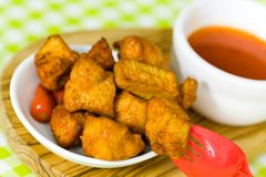 Delicious spicy chicken breast with chili sauce Stock Images