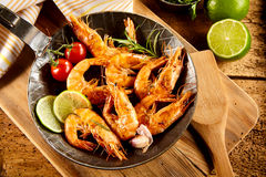 Delicious spicy grilled prawns with trimmings Stock Images