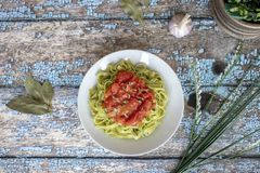 Delicious spinach fettuccine with passata sauce stock image