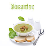Delicious spinach soup with bread, isolated on white Royalty Free Stock Photo