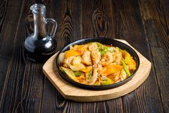 Delicious squid with vegetables stock images