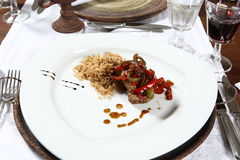 Delicious starter. An appetizing starter with noodles and vegetables on a big white plate stock images
