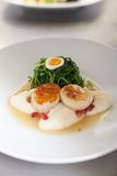 Delicious starter of stuffed savoury eggs scallops Royalty Free Stock Photos