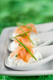 Delicious starters. Delicious small amuse on three spoons with creamcheese and smoked salmon Royalty Free Stock Images