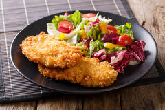 Delicious steak in breadcrumbs Panko and fresh vegetable salad c Stock Photography