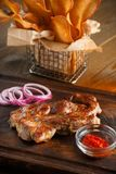 Delicious steak with chili sauce and chopped onion Royalty Free Stock Photo
