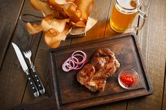 Delicious steak with chili sauce and chopped onion Royalty Free Stock Images