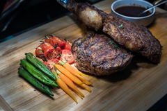 Delicious Steak on cutting board Royalty Free Stock Images