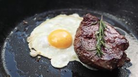 Delicious steak with egg. stock footage