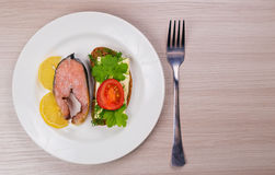 Delicious steak fillet red salmon fish on a plate. Stock Photo