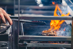 Delicious steak on grill Stock Photography