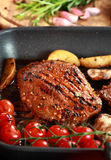 Delicious steak with grilled vegetable Royalty Free Stock Images