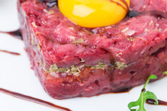 Delicious steak tartare with egg yolk. Royalty Free Stock Images