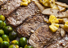 Steak. Delicious steak with vegetables and different fruits Royalty Free Stock Photography