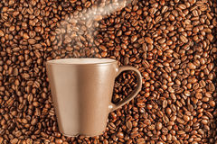 Delicious steaming hot coffee on beans 1 Royalty Free Stock Images