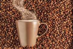 Delicious steaming hot coffee on beans 3 Royalty Free Stock Photo