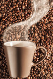 Delicious steaming hot coffee on beans 4 Stock Photography