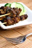 Delicious steaming satay Royalty Free Stock Images