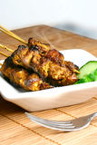 Delicious Steaming Satay Stock Photo