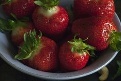 Delicious strawberries in the bowl. Macro photography. Delicious strawberries fresh in the bowl. Macro photography stock photography