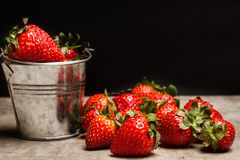 Delicious red strawberries in a galvanized bucket royalty free stock photo