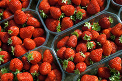 Delicious strawberries in plastic containers Stock Photo