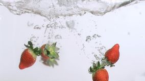 Delicious strawberries in super slow motion falling stock video