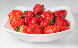 Delicious strawberries on the white plate. Stock Image