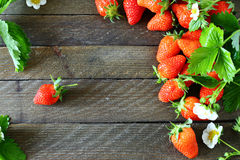 Delicious strawberries on wooden boards Stock Photo