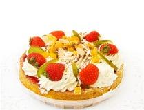 Delicious strawberry cake. Fresh strawberry and tropical fruits cake. Isolated on white background Stock Photos