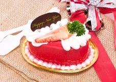 Delicious strawberry cake. Delicious strawberry with bells and ribbon on burlap Stock Photos