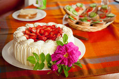 Delicious strawberry cake on coffee table Royalty Free Stock Photo