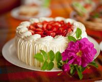 Delicious strawberry cake on coffee table Stock Photo