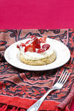 Delicious strawberry cake on party table Stock Photo